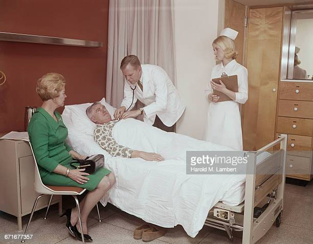 Doctor Checking Patient At Hospital