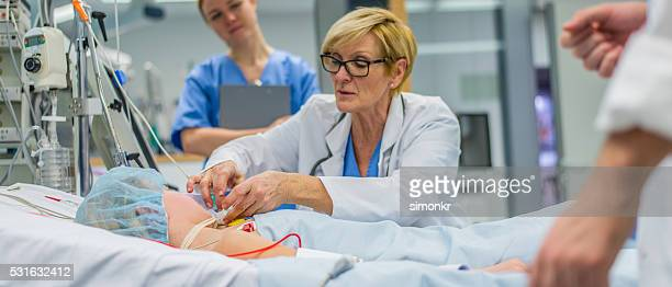 doctor checking patient - intensive care unit stock pictures, royalty-free photos & images