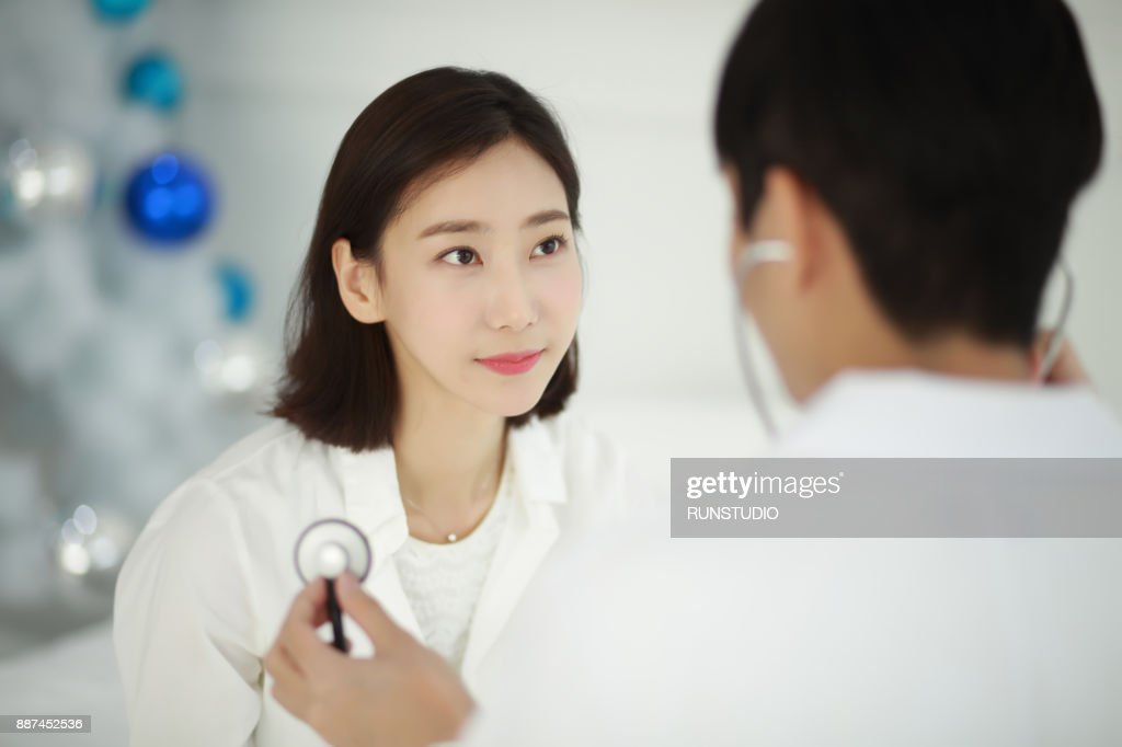 doctor checking patient with stethoscope : Stock Photo