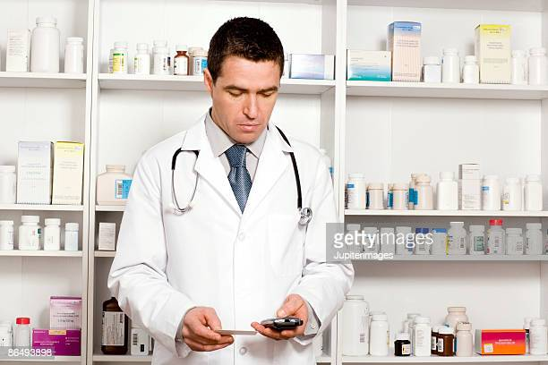 Doctor checking portable communication device