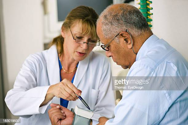 Doctor Checking the Blood Pressure of Her Patient