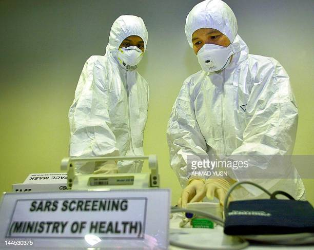 Doctor checks equipment at a Severe Acute Respiratory Syndrome screening room at Kuala Lumpur International Airport, 05 April 2003. A 64-year-old man...
