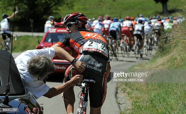 A doctor checks the leg of Spanish Imanol Erviti Ollo on June 11 during the 5th stage of the 61th edition of the Criterium of Dauphine Libere cycling...