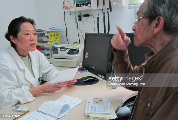 Doctor Chen Hua talks with her patient in a clinic at Zhoujiaqiao Community Health Centre in Changning district Shanghai 08MAY14