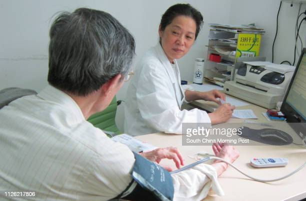 Doctor Chen Hua talks with her patient Tao Naiyu in a clinic at Zhoujiaqiao Community Health Centre in Changning district Shanghai on May 08 2014