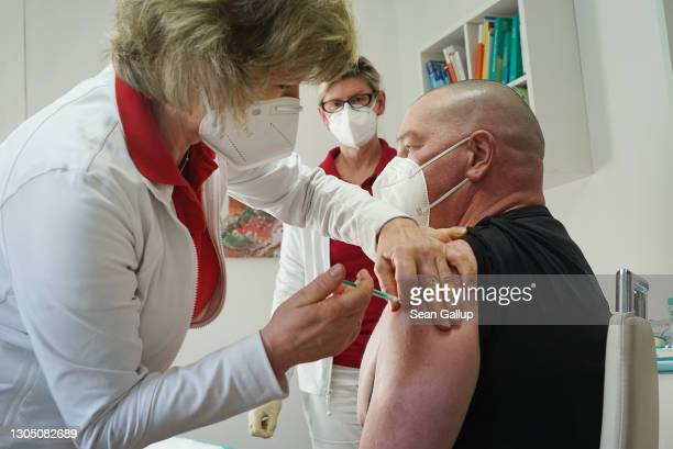 Doctor Claudia Richartz inoculates a health care worker against COVID-19 with the AstraZeneca vaccine at her private practice as part of a pilot...