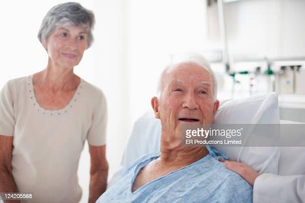 Doctor comforting patient in hospital