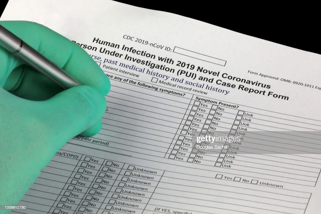 Doctor completing the CDC form for reporting Corona-virus investigation case report : Stock Photo