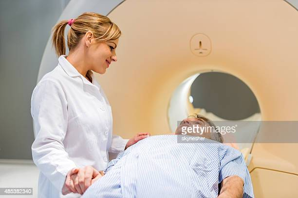 Doctor consoling a patient before MRI scan.