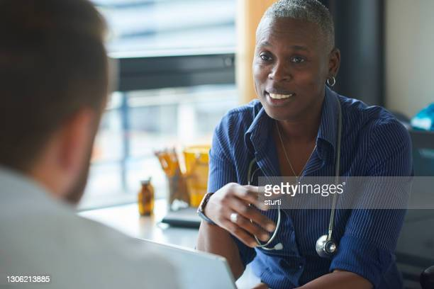 doctor consultation - doctor stock pictures, royalty-free photos & images