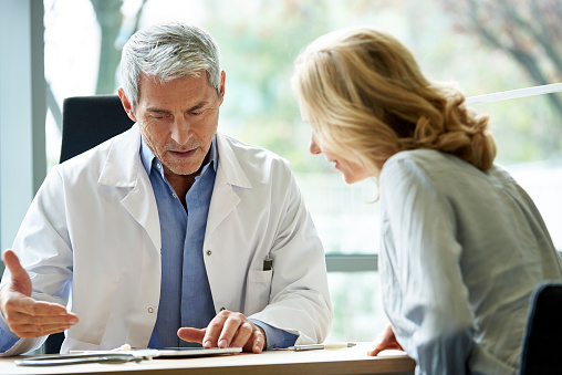 Doctor consulting patient in clinic - gettyimageskorea