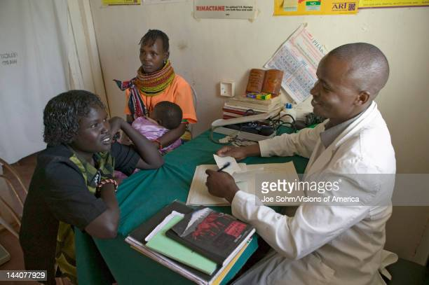 A doctor consults with mother and children about HIV/AIDS at Pepo La Tumaini Jangwani HIV/AIDS Community Rehabilitation Program Orphanage Clinic Pepo...