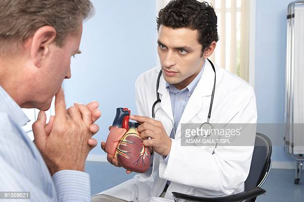 Doctor conversing with patient about heart