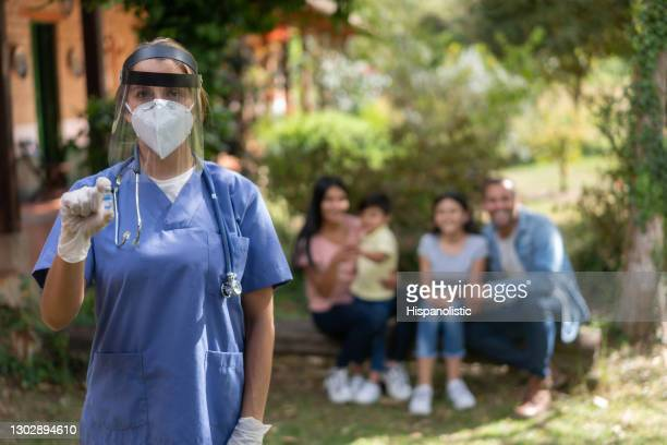 doctor delivering covid-19 vaccines in the countryside - poverty stock pictures, royalty-free photos & images