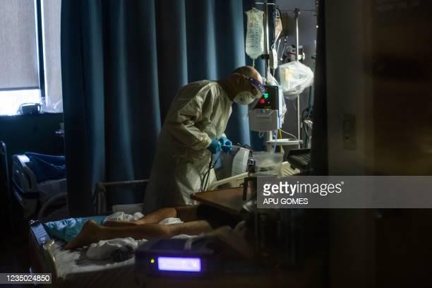 Doctor Delkhah Shahin checks on a 34 year old, unvaccinated Covid-19 patient at Providence Cedars-Sinai Tarzana Medical Center in Tarzana, California...