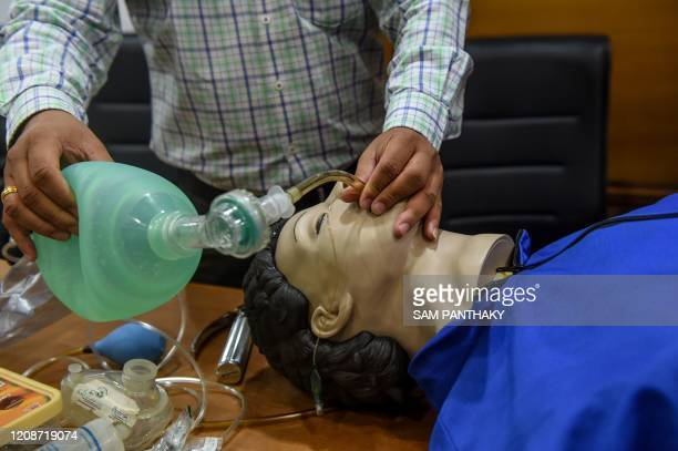 A doctor demonstrates various techniques to help breathing on a dummy at a workshop during a governmentimposed nationwide lockdown as a preventive...