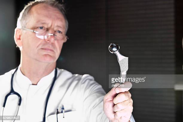 Doctor demonstrating total hip endoprothesis
