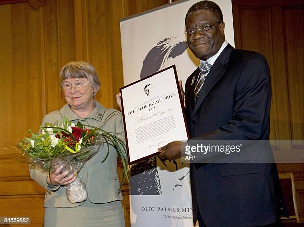Doctor Denis Mukwege receives the Olof Palme Prize 2008 from Palme's widow Lisbeth Palme during a ceremony in at the Swedish Parliament in Stockholm...