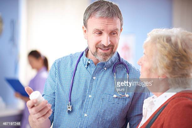 doctor discussing medicine with a senior patinet