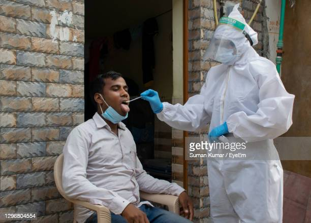 doctor doing corona test at the door of house - india stock pictures, royalty-free photos & images