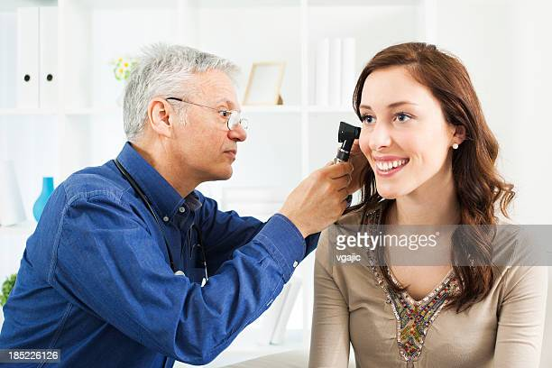 Doctor Doing Ear Exam With Otoscope