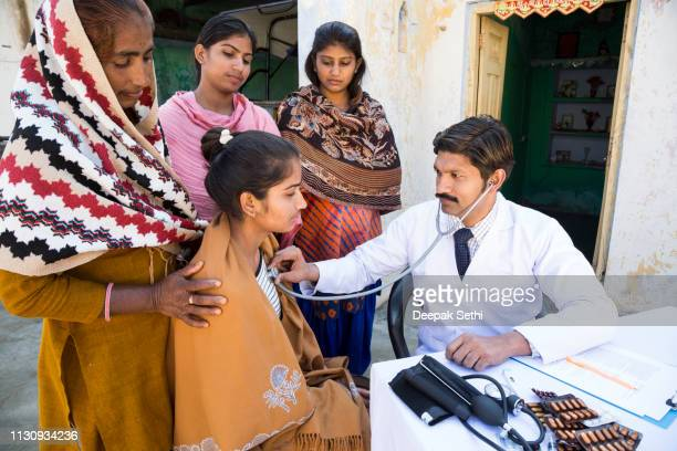doctor doing social service in village - medical condition stock pictures, royalty-free photos & images