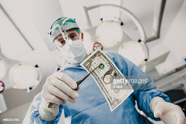 Doctor doing surgery in hospital with money