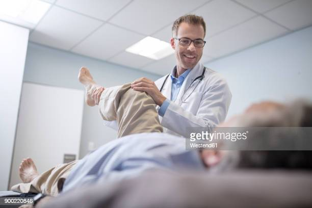 Doctor examiming senior patient in medical practice