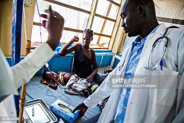 A doctor examines a child with acute malnutrition at the clinic run by Doctors without Borders in Aweil Northern Bahr al Ghazal South Sudan on...