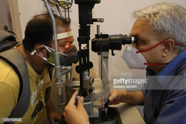 Doctor examines a patient who recovered from the Covid-19 coronavirus for symptoms of Black Fungus or scientifically known as Mucormycosis, a deadly...