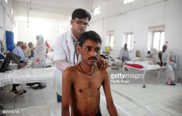 A doctor examines a tuberculosis patient in a government TB hospital on 'World Tuberculosis Day' in Allahabad