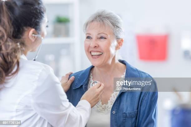 Doctor examines senior woman