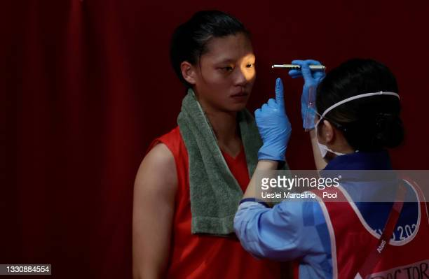Doctor examines Shih Yi Wu of Chinese Taipe for injuries after the Women's Light on day four of the Tokyo 2020 Olympic Games at Kokugikan Arena on...