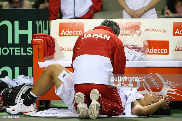 A doctor examines Tatsuma Ito of Japan in his match against Radek Stepanek of Czech Republic in a match between Japan v Czech Republic during the...