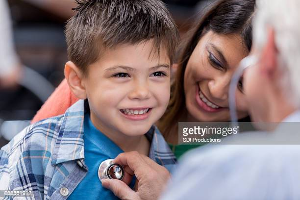 Doctor examines young patient during well check