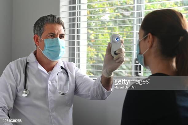 doctor examining a female patient health - rafael ben ari imagens e fotografias de stock