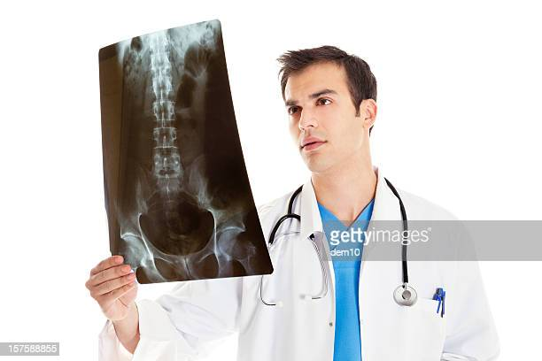 doctor examining a sacrum x-ray - pelvis stock pictures, royalty-free photos & images