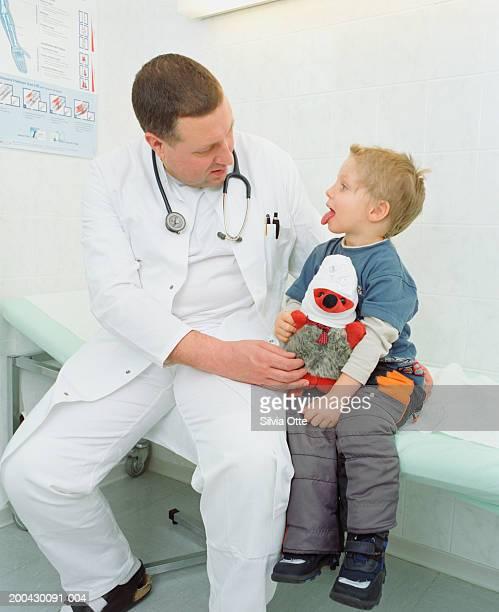 Doctor examining boy (2-4)
