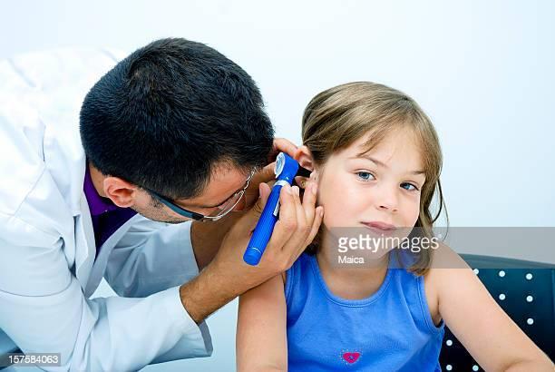 Doctor examining child ear