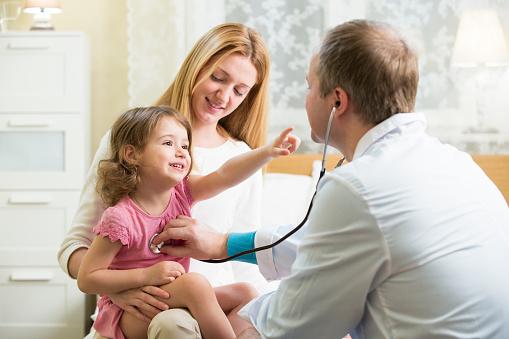 Doctor examining child 612721732