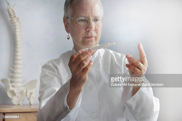 Doctor examining equipment in office