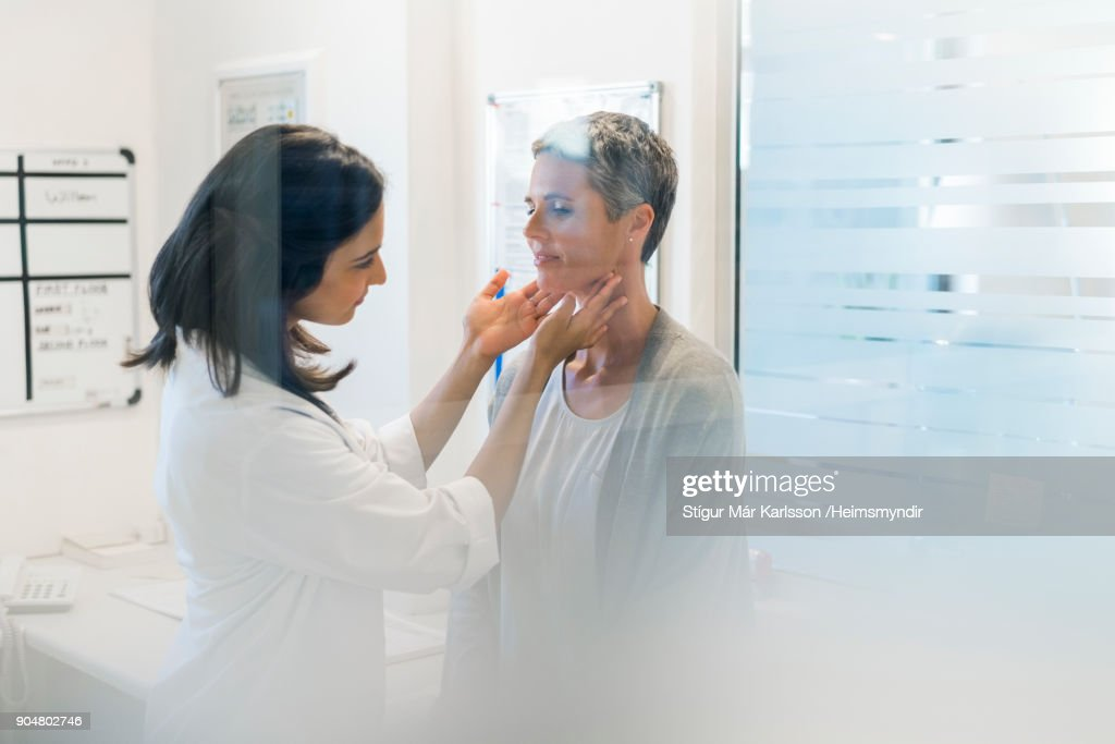 Doctor examining female patient fat hospital : Stock Photo