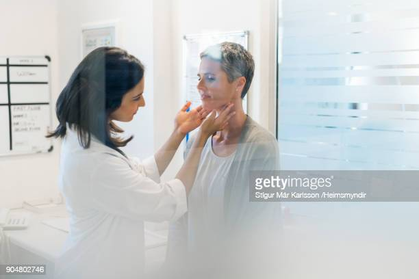 doctor examining female patient fat hospital - visita imagens e fotografias de stock