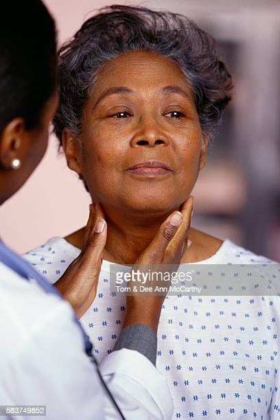 doctor examining female patient - gerontology stock pictures, royalty-free photos & images