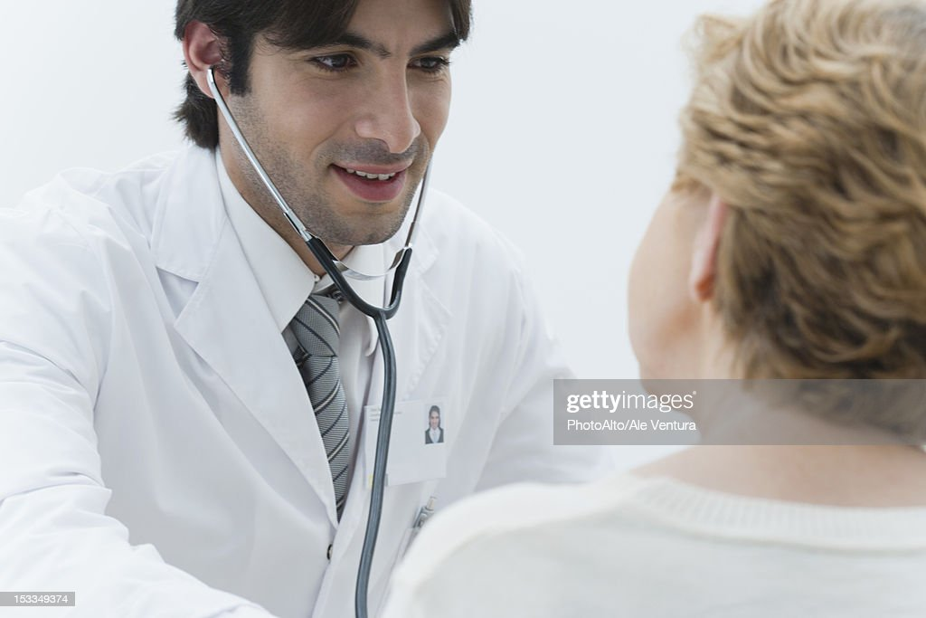 Doctor Examining Patient Using Stethoscope Stock Photo ...Doctor Stethoscope Comment