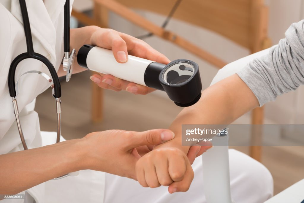 Doctor Examining Skin Of Child Patient : Stock Photo