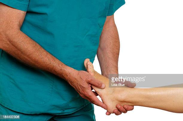 doctor examining woman foot - human foot stock pictures, royalty-free photos & images