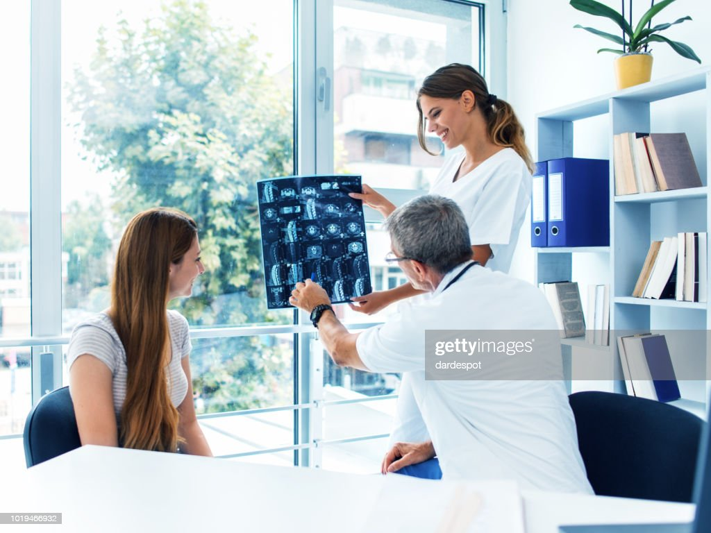 Doctor examining x-ray : Stock Photo