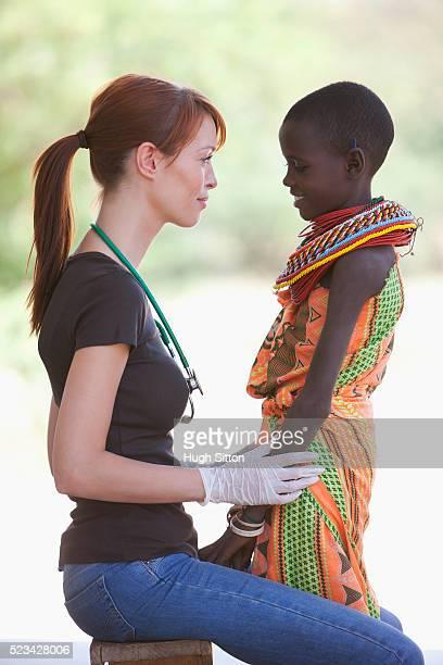 doctor examining young samburu girl, kenya - hugh sitton stock pictures, royalty-free photos & images
