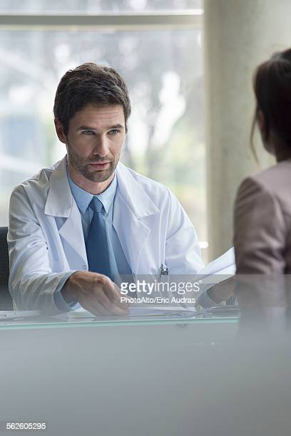 Doctor explaining concerning results to patient